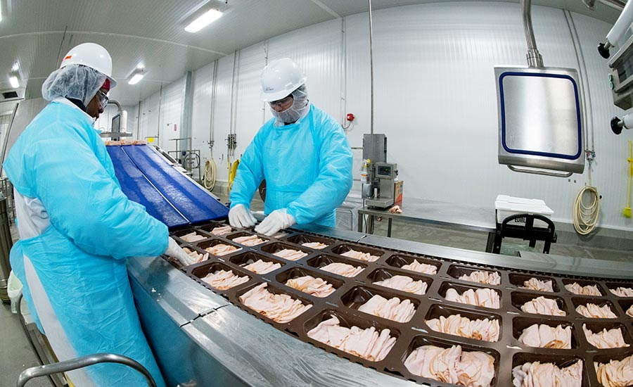 Workers on slicing line