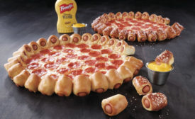 Pizza Hut brings hot dog crust pizza to US