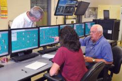 Operators at the controls of Wild Turkey's new batch process control