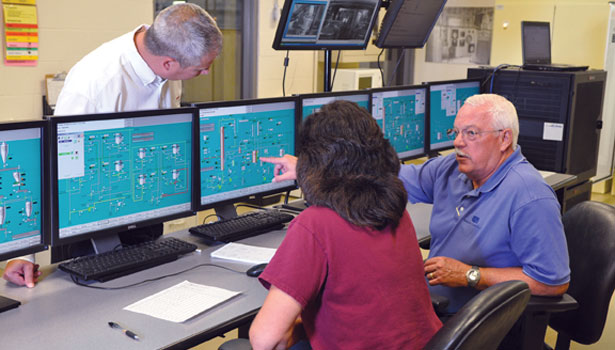 Operators at the controls of Wild Turkey's new batch process control