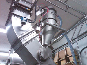 Nutriom uses two VAC-U-MAX pneumatic conveyors with a mixer. One system breaks up the powder and puts it into the mixer, while the other pulls it out of the mixer.