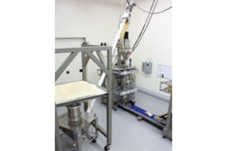 The Hapman Helix flexible screw conveyor conveys imported rice from its integral stainless steel hopper into a packaging machine