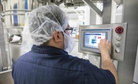SaltWorks employee using controls for grinder