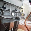 employee cleans food processing equipment