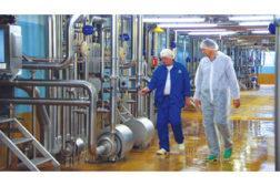 pumps men working food plant