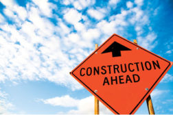 construction sign blue sky