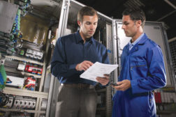 two men process control manufacturing