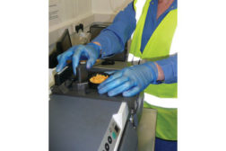 man in gloves measuring food manufacturing