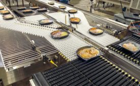 Conveying ready-to-eat meals through production processes