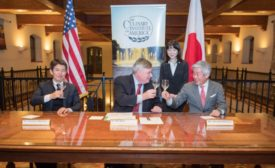 Dr. Tim Ryan, president of The Culinary Institute of America, shares a sake toast with Chairman Hiroshi Sakurai (right) and President Kazuhiro Sakurai of Asahi Shuzo to celebrate a new agreement between the CIA and the Japanese sake producer.